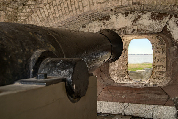 A canon points through a porthole inside Fort Sumter at the Fort Sumter National Monument in Charleston, SC on Wednesday, January 15, 2014. Copyright 2014 Jason Barnette  Construction began on Fort Sumter in 1829, but was still unfinished in 1861 when the Civil War began. On April 12, 1861 Confederate batteries opened fire on Fort Sumter, marking the first shots fired during the Civil War. Today Fort Sumter is part of the Fort Sumter National Monument which includes the fort, the Fort Sumter Education Center, and Fort Moultrie.