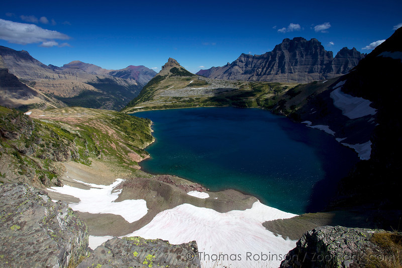 The alpine deep blue Sue Lake at 7145ft (2178m) in the shadow of Mount Kipp and Pyramid Peak in Glacier National Park, Montana.
