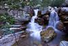 Apikuni Creek tumbles down a short falls near Apikuni Falls in Glacier National Park.