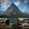 Located near the base of Mt. Grinnell deep in the heart of Glacier National Park, Montana. This enormous five-story Swiss Chalet themed lodge stretches along the shores of beautiful Swiftcurrent Lake. Opened in 1915, this beautiful lakeside hotel with its more than 200 guest rooms is the largest national park lodge in Glacier National Park and for many years the largest hotel in Montana. The scenery here is world famous with sweeping panoramic views of the pristine Swiftcurrent Lake surrounded by nearby Grinnell point, Mt. Henkel, and the awesome Northern Rocky Mountains.  Sony DSC-H2; SV-1/640, AV-f/4, ISO-80, 6mm.