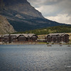 Located near the base of Mt. Grinnell deep in the heart of Glacier National Park, Montana. This enormous five-story Swiss Chalet themed lodge stretches along the shores of beautiful Swiftcurrent Lake. Opened in 1915, this beautiful lakeside hotel with its more than 200 guest rooms is the largest national park lodge in Glacier National Park and for many years the largest hotel in Montana. The scenery here is world famous with sweeping panoramic views of the pristine Swiftcurrent Lake surrounded by nearby Grinnell point, Mt. Henkel, and the awesome Northern Rocky Mountains. Sony DSC-H2; SV-1/500, AV-f/4, ISO-80, 21mm.