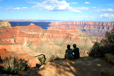 Couple looking over Grand Canyon