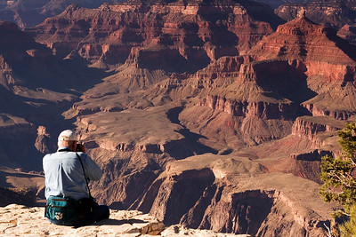 Tourist Shooting The Grand Canyon From Yavapai Point