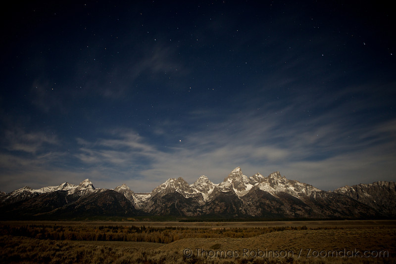 Stars shine out above the Grand Teton mountains. The 13,000 foot mountains are formed from an uplifted tectonic plate.