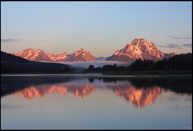 "Mt. Moran and Oxbow Bend, Sunrise, Grand Teton National Park  The magenta hue of sunrise light up Mt. Moran at Oxbow Bend. Oxbow Bend on the Wyoming's Snake River is one of Grand Teton National Park's most recognizable landmarks.  Oxbow Bend is a ""bend"" or looping meander of the Snake River which has been cut off from the main channel. It resembles the oxbow used by the western pioneers. The river sits at the northern flank of Signal Mountain east of Jackson Lake. Mount Moran of the Teton Range dominates the landscape."