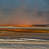 In 2010 I capture a breathtaking view of the Grand Prismatic Spring but failed to get a view of it from the side on lower ground.  We drove up into southern Yellowstone on our last day in hopes of finding Elk and to get this shot.  There is a halo of orange and blue steam that hovers over this spring.