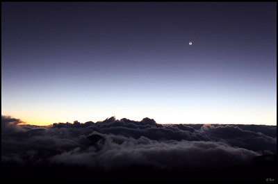 Moon and the ocean of clouds before sunrise, Haleakala National Park  Maui, Hawaii