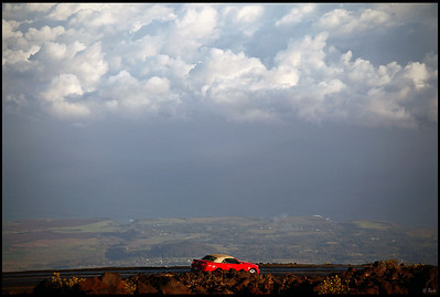 A red coupe driving near the top of the Haleakala crater  Haleakala National Park, Maui, Hawaii
