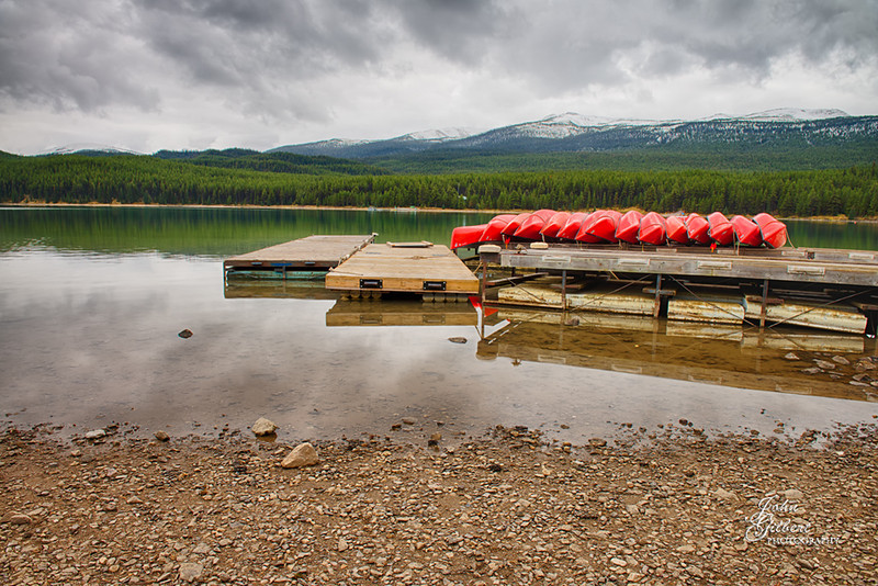 Maligne Lake Boat Dock 10/02/2013:  Reached our destination but it was late morning and very cloudy so any chance of lake shots with mountain reflections was not an option.  However, in the world of photography there is always something to take a picture of.  Couldn't resist the red of these canoes.<br /> <br /> Nikon D600, 24-70mm Lens @ 24mm.  Three exposures:  Aperture f/8, Shutter Speeds 0.6, 1/4, and 0.6 with 0.0, -0.67 and +0.67 EV.  Blended together in PS6.