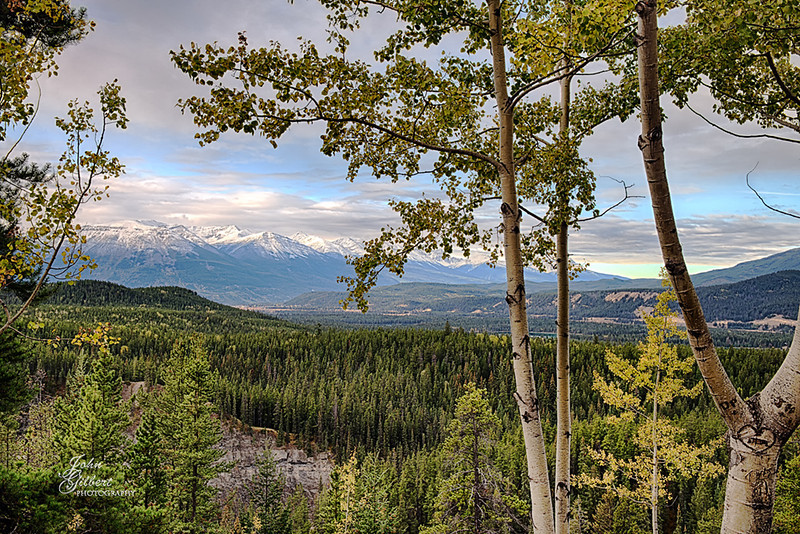 Day 3 Scenic Overlook 10/02/2013: The mountains left center are of Whistler's Mountain,  Directly below them is the town of Jasper and the lower left hand corner is the Maligne Canyon. The upper right is the beginning of the Pyramid Mountains which rise above the Athabasca Valley.