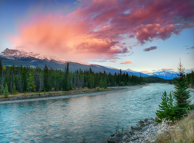 Astoria River 10/02/2013:  As the day drew to an end we headed back to Jasper along the Mt Edith Cavell Road which runs parallel to the Astoria River.  As the sun was going down we came across this beautiful red/pink sky from the setting suns reflection on and through the clouds.  The glacial waters always make for a colorful foreground.