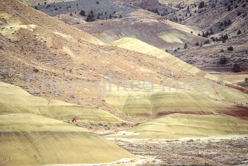 Winter bike tourer on dirt road in Oregon's John Day Fossil Beds Nat'l Monument - 72 ppi 11