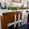 Christmastime - stockings over the fireplace.  The 'skull' photo is actually a trick photo of a woman on a bed.