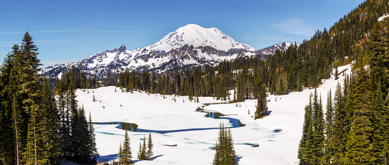 Mt. Rainier scoffs at June sunshine