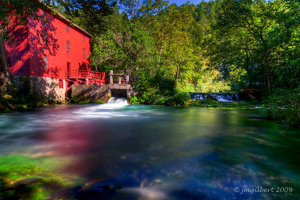 Alley Spring Mill, Missouri:  Cold, clear waters rise from deep Alley Spring with an average daily flow of 81 million gallons. The spring basin is funnel-shaped with a depth of 32 feet.  This photo consisted of 3 shots bracketed at 2 f/stop intervals and then merged together in Photomatrix (HDR Process)