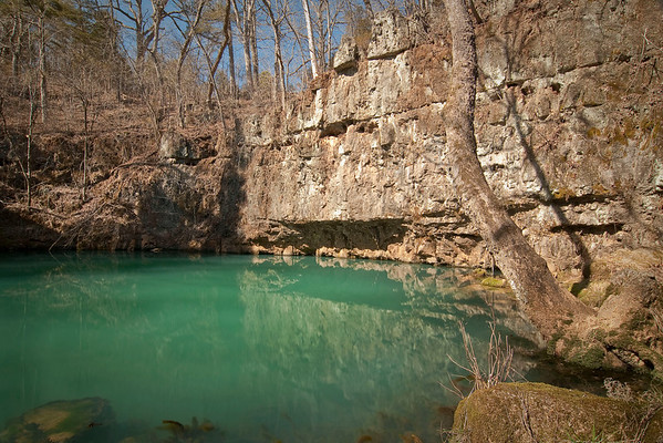 Round Spring locate off of state highway 19 north of Eminence, Missouri.  The water is actually this green.