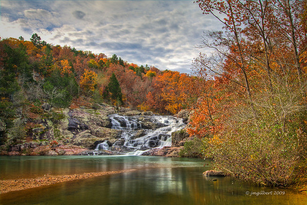 Rocky Falls, northeast of Winona, Missouri or southeast of Eminence off of State Highway H, then east on NN.  This shot was 3 frames bracketed and then processing in Photmatrix as a HDR.  Rocky Falls is part of the Ozark National Scenic Riverways located in south central Missouri.  Rocky Falls is the highest water falls in Missouri and is fed by natural springs.  Local residents can be found swimming, during the hot summer months, in the pool below this fall.  Picnic facilities and clean restrooms are available within walking distance of the falls.
