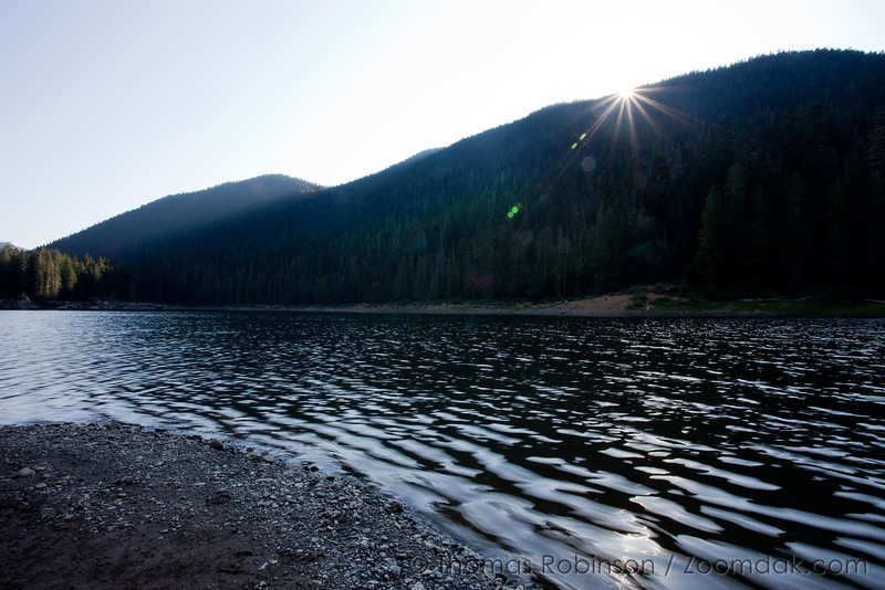 The sun sets over the hills above Lena Lake.