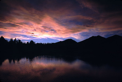 This is Sprague Lake, RMNP at dawn.  The sun was still below the horizon but the reflected light off the clouds tuned the sky red and blue. This is one beautiful place.