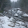 Stream with snow covered rocks