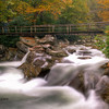 Fall 2009:  One of three cascades and bridges along the Chimney Top Trail.  I was shooting in bracket mode with shutter the slowest speed of 4 sec. resulting in what appears to be blurred spots but is snow falling.  This photo was processed as an HDR in Photomatrix.