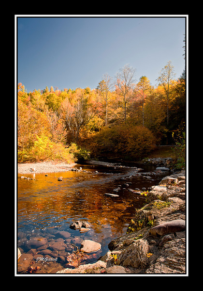 NJG3411: This picture was taken at the intersection of 73 and Little River Road.  As we came around the corner we immediately noticed the fall colors being reflected off the water.  It was time to stop and set up the equipment.
