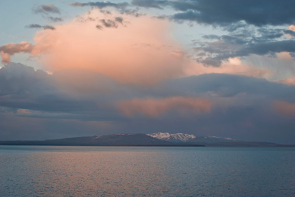 This is Yellowstone Lake at 6:54 in the morning with the Absaroka Range in the background.  There was a beautiful orange glow in the sky and even highlights the lake.