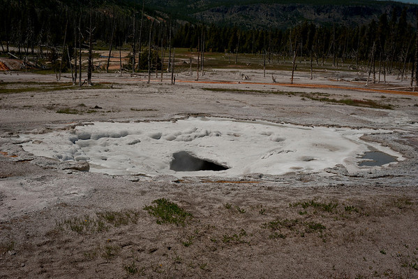 Spouter Geyser: Black Sand Basin northwest of Old Faithful.  Named for sand derived from black volcanic glass, this basin features some of the most splendid hot springs in Yellowstone.