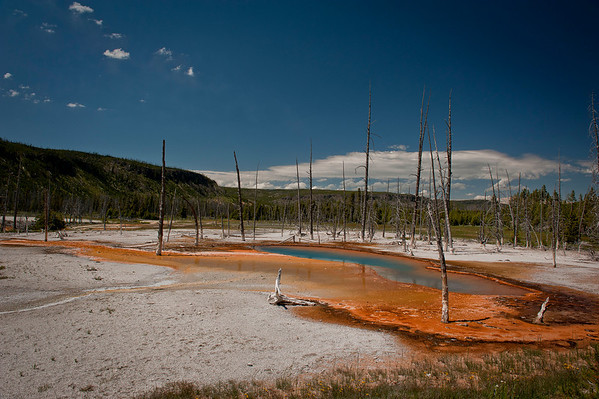 Opalescent Pool: Black Sand Basin northwest of Old Faithful.  Named for sand derived from black volcanic glass, this basin features some of the most splendid hot springs in Yellowstone.