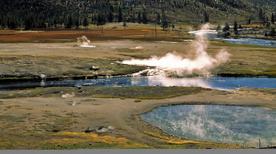The Madison River winds through western Yellowstone and absorbs additional water from pools of geysers and pits.