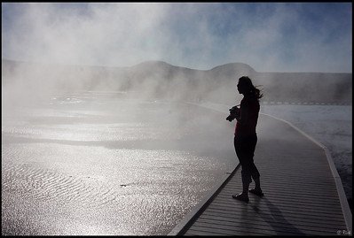 Photographer silhouette, Grand Prismatic Spring, Yellowstone National Park  A photographer stood still among the waves of steam coming from the pool, Grand Prismatic Spring, Yellowstone National Park.  The Grand Prismatic Spring is the largest hot spring in the United States, and the third largest in the world. It is located in the Midway Geyser Basin.