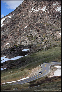 "Beartooth Highway, Yellowstone National Park  The Beartooth Highway is an All-American Road that has been called ""the most beautiful drive in America,"" by late CBS correspondent Charles Kuralt. Due to heavy snowfall at the top, the pass is usually open each year only from Memorial Day in late May through Labor Day in September.  The Beartooth Highway is the section of U.S. Highway 212 between Red Lodge, Montana and Cooke City, Montana. It traces a series of steep zigzags and switchbacks, along the Montana-Wyoming border to the 10,947 ft (3,337 m) high Beartooth Pass. The approximate elevation rise is from 5,200 ft (1,600 m) to 8,000 ft (2,400 m) in 12 mi (19 km) in the most daring landscapes.  Due to the high altitudes, snowstorms can occur even in the middle of the summer and the pass is also known for strong winds and severe thunderstorms."