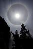 A sun halo (or gloriole) encases a circle in the sky above Nevada Falls.