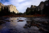 El Capitan and Cathedral Peaks reflect off the morning waters of the Merced River in Yosemite valley.