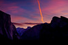 Sunrise from tunnel view shows Half Dome down Yosemite Valley with El Capitan and the Cathedral Peaks in the foreground.