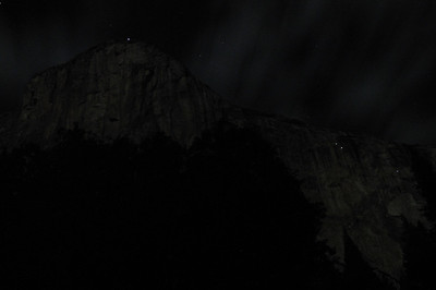 Mountain Climbers camping on the granite face at night. Four lights are visible - three on the right side and one at the very top. This was a 30 second exposure with only the moonlight illuminating the granite face.