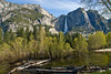 Upper Yosemite Falls with the Merced River in the foreground.