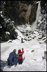 Tourists in front of Lower Yosemite Fall, winter