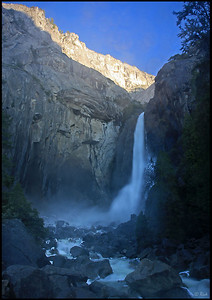 Lower Yosemite Falls, with the first light hitting the granite walls, sunrise