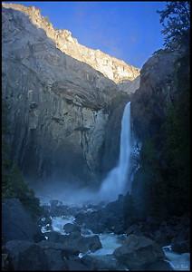Lower Yosemite Falls, with the first light hitting the granite walls, sunrise