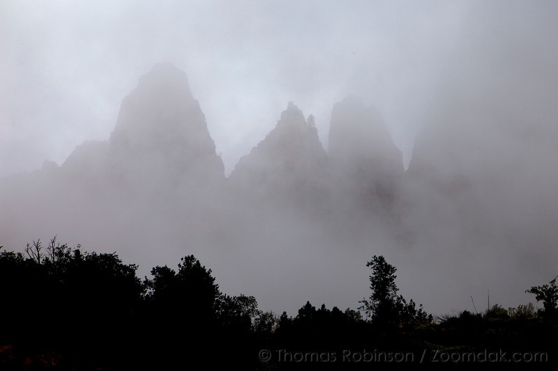 Precipices near Bridge Mountain are obscured by the clouds in Zion National Park.