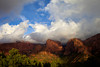 The Colorado Plateau is visible below the clouds from the Kolob Canyon viewpoint in Zion National Park. Most notably, Nagunt Mesa (center) at 7785ft (2372m) and Timber Top Mountain (right) at 8055ft (2455m).