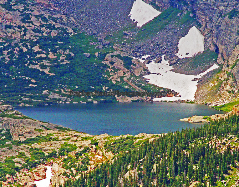 Glacial lake was seen and photographed in Rocky Mountain National Park.