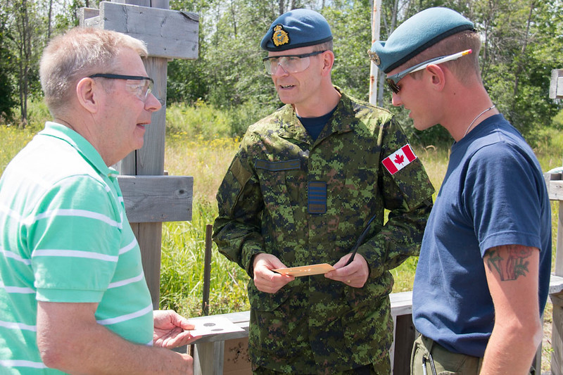 Colonel Perrault and Bill Fletcher at Terry Whitty Air Rifle Range on July 28, 2017 at Connaught Cadet Training Centre.  Photo credit: Captain Grant Cree, Unit Public Affairs Representative. Connaught Cadet Training Centre.  Credit Photo: capitaine Grant Cree, représentant des affaires publiques de l'unité. Centre d'entrainment des cadets Connaught. © 2017 DND-MDN Canada