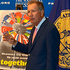Gov. John Kasich of Ohio at press conference, with poster promoting the Marshall Plan