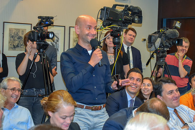 Audience member asking question of Gov. John Kasich