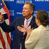 Gov. John Kasich of Ohio checks out gift mug from National Press Club president Andrea Edney.