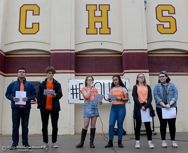 A handfull of students stand in front of the student body and read names of those killed in the Parkland, Florida shooting last month. Chico High School students participate in the National Walkout to end school violence by honoring those killed with a moment of silence and a handfull of students spoke on the subject. Students also posted banners and set up a voting pre-registration table where students 16-years or older are allowed to pre-register to vote Wed. March 14, 2018.  (Bill Husa -- Enterprise-Record)
