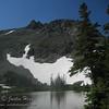 A two exposure stitch of Lake Helene below Flattop Mountain.