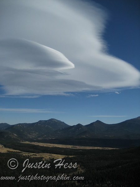 A lenticular cloud forming over Twin Sisters, Estes Cone, Moraine Park and Upper Beaver Meadows - viewed from Many Parks Curve.